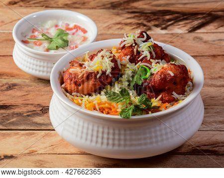 Chicken Tikka Biryani Made Of Basmati Rice Cooked With Masala Spices, Served With Yogurt, Selective
