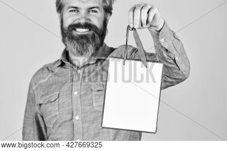 Retail Concept. Hipster Buying Sale Price. Cyber Monday Sale. Nice Purchase. Bearded Man Hold Shoppi