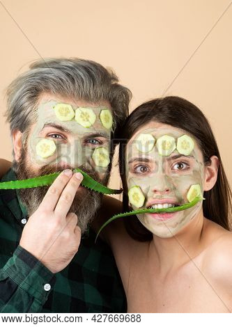 Funny Couple Spa Mask, Aloe Vera And Cucumber On Face. Mud Facial Mask, Face Clay Mask Spa. Man And
