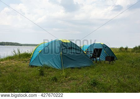 Tourist Tents For Camping On The Lake Shore, Travel History. Fishing, Tourism, Active Recreation. Na