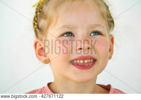 Saliva. Drooling On The Tongue In Kid Mouth. Cheerful Smile Child. Close-up Of Face On White Backgro