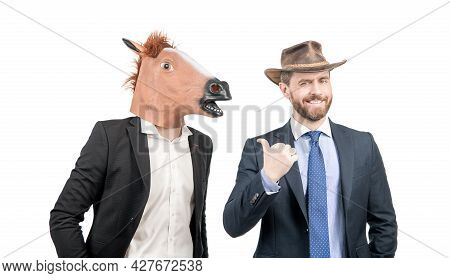 Happy Cowboy Man Point Finger At Businessman Wearing Horse Head. Western Party. Cowboy Party