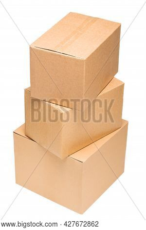 Corrugated Cardboard Boxes Of Different Sizes Are Stacked On Top Of Each Other On An Isolated White