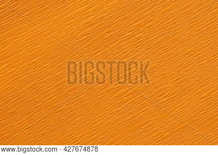 Close Up Of An Orange Crepe Paper Crinkly Texture