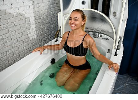 Young Woman Receiving Wellness And Medical Procedures And Treatment In Spa Wellness Capsule. Bathhou