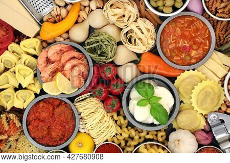 Italian healthy food for a balanced diet high in antioxidants, anthocyanins, fibre, lycopene, omega 3 and protein. With meats, seafood, cheese, vegetables, pasta,soup and herbs. Health food concept.