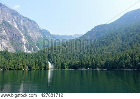 An Incredible View Of Princess Louisa Inlet And Chatterbox Falls, With A Huge Waterfall And Giant Cl
