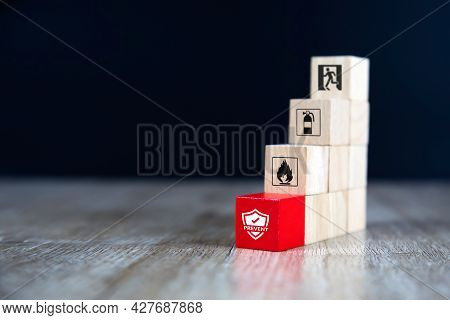 Fire, Cube Wooden Toy Block Stack With Prevent Icon With Fire Extinguisher And Door Exit And Emergen