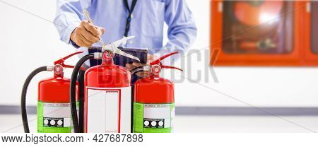 Fire Extinguisher, Engineer Inspection And Checking Pressure Gauge Level Of Fire Extinguisher Tank I