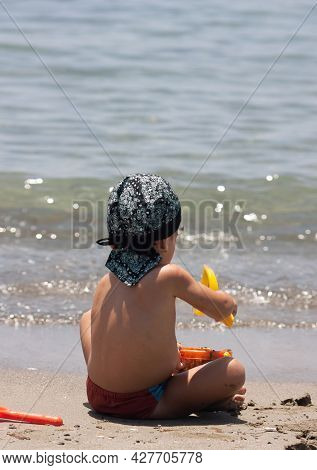 Healthy Lifestyle. Boy On Seashore