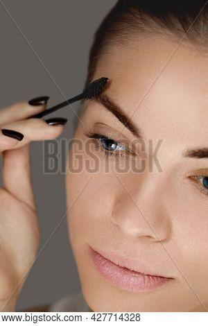 Young Woman Undergoing Eyebrow Correction Procedure, Closeup