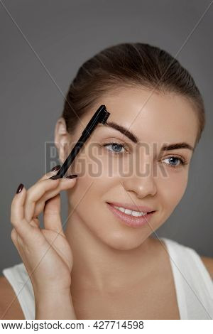 Eyebrows Correction And Contouring .  Beautiful Woman Shaping Brows With Comb.  Eyebrows And Eyelash