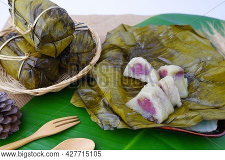 Bundled Boiled Rice. Banana And Sticky Rice Wrapped In Banana Leaves And Black Bean Paste On Bamboo