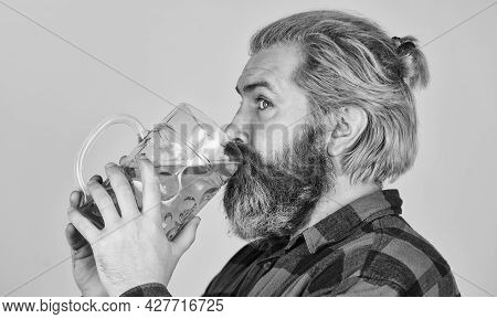 Craft Beer Industry. Beer Pub. Stylish Bartender Or Barman In Bar. Recreation. Man Hold Glass Of Bee