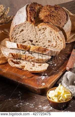 Freshly Artisan Baked Wheat And Rye Bread, Country Bread. Simple Bread  With Butter For Breackfast