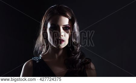 A Mysterious Gorgeous Pale Lady With Dark Hair And Scarlet Lipstick In The Shade.