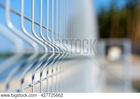 Metal Lattice Vertical Fence Of The Beach, With A Background Blur. A Territory Free Of Covid-19. Con