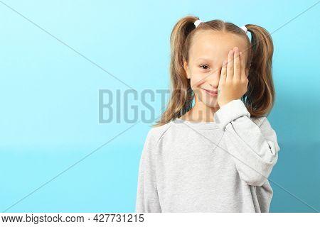 Cute Little Girl Checks Eyesight With An Ophthalmologist. Eyesight Test