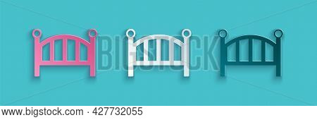 Paper Cut Baby Crib Cradle Bed Icon Isolated On Blue Background. Paper Art Style. Vector