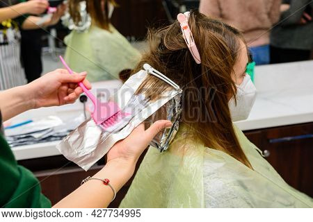 Hair Coloring During The Quarantine Period, Client And Hairdresser In Masks, Hair Bleaching.