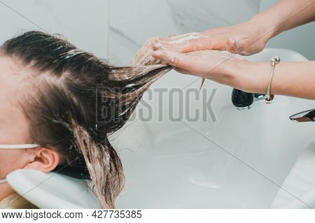 The Hairdresser Washes Off The Hair Dye, Scalp Wash And Hair Dyeing Process.