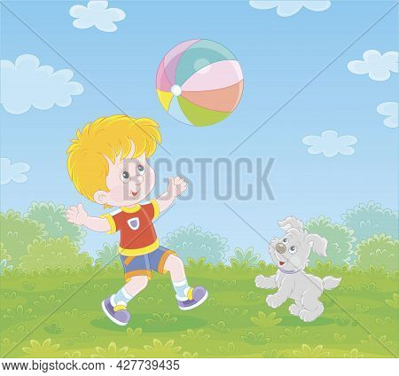 Happy Little Boy Running And Playing A Big Colorful Ball With His Cute Merry Pup On Green Grass Of A