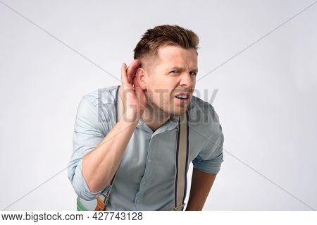 Man Putting Hand Near Ear Listening For A Quiet Sound Or Paying Attention