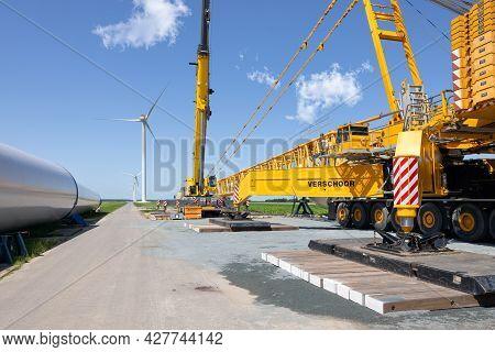 Zeewolde, The Netherlands - Juli 17, 2021: Dutch Construction Site New Wind Turbine Farm In Zeewolde