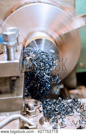 End Trimming With A Cutter On A Lathe. Metal Shavings On The Machine.