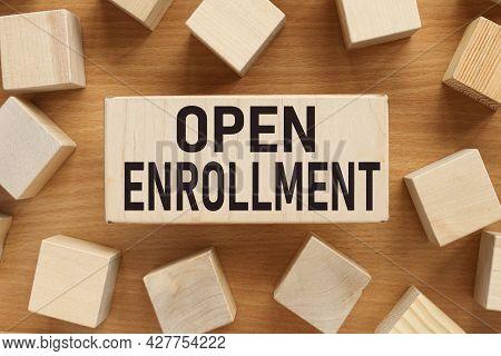 Open Enrollment, Text On Wood Board Near Wood Cubes
