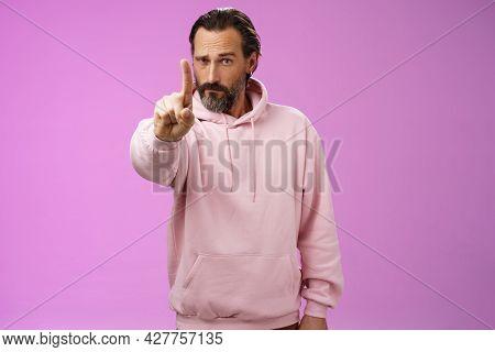 One Rule Listen. Serious-looking Bossy Focused Determined Adult Bearded Male In Pink Hoodie Extend I