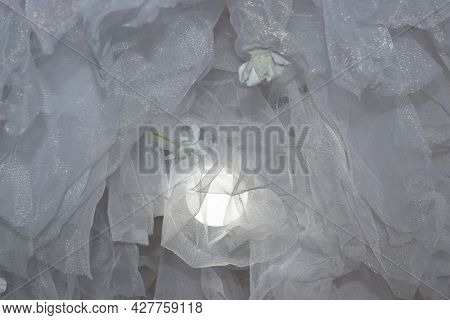 White Organza Fabric Folded In Folds, Background. High Quality Photo
