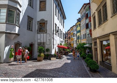 Bolzano, Italy, June 2021. A Secondary Street In The Historic Center. People On The Street, Bright,