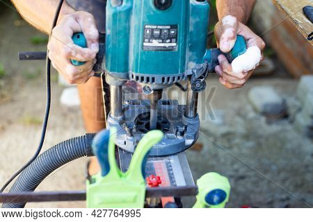 A Carpenter Works With A Wood Milling Machine. Professional Tools For Woodworking.