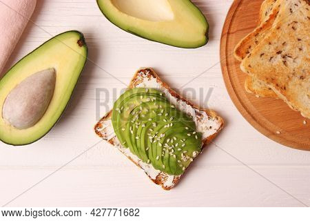 Toasted Toast With Avocado On A Wooden Table.