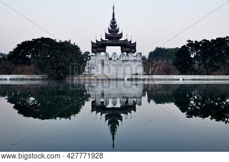 View Landscape And Ancient Building Fortresses And Reflection On Surface Of Water Moat Canal For Bur