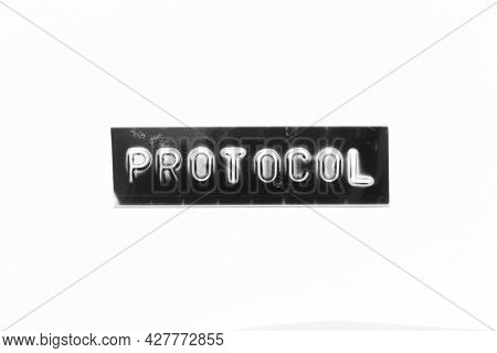 Embossed Letter With Word Protocol In Black Banner On White Paper Background