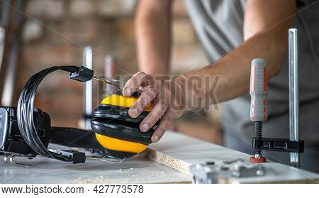 Professional Carpenter Workplace With Protective Headphones, Personal Protection For Work At Woodwor