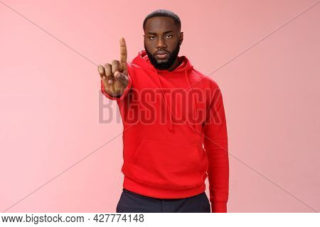Wait Second. Serious-looking Annoyed Strong Brutal African American Older Brother Show Index Finger