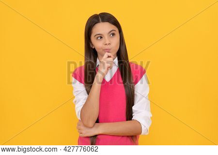 Tween And Youth. Casual Fashion. Thinking Teen Girl On Yellow Background. Childhood Happiness.