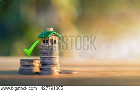Mortgage And Loan Approved Concept:  House On A Coin Pile. Planning Savings Money Of Coins To Buy A