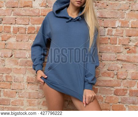 Hoodie mockup. Unrecognizable woman wears blue hoodie. For fashion mock up. Casual outfit for lady.