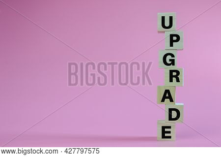 Stack Of Wooden Blocks With Text Upgrade