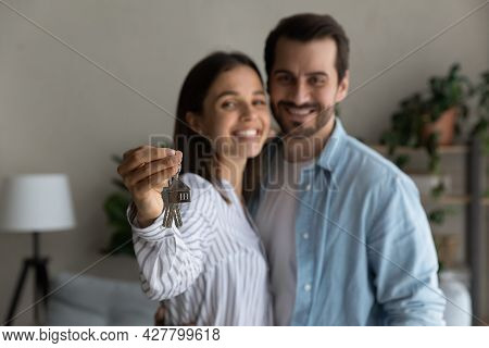 Happy Married Couple Holding Keys From New Bought House, Closeup