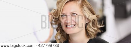 Portrait Of Smiling Woman Who Has Her Hair Done From Curls