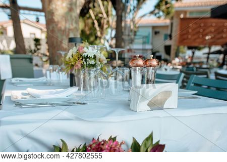 Served Table In The Open-air Restaurant. Concept Of Holidays And Wedding.