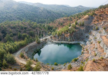 Lake In Abandoned Pit Of Basalt Quarry Near Machairas, Cyprus. Aerial Landscape