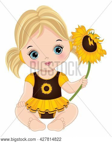 Cute Little Baby Girl Is In Yellow And Brown Dress Sitting. Blond Little Girl Is With Ponytails, Hol