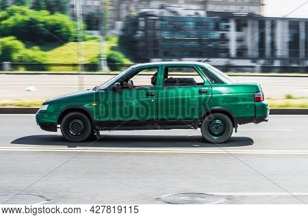 Moscow, Russia - July 2021: Old Green Lada 2110 In Motion. Speeding In City Road Concept. Obsolete M