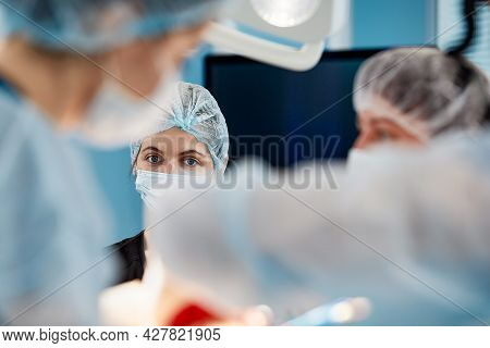 Surgeon At Work In The Operating Room Modern Equipment In The Operating Room, Medical Products For N